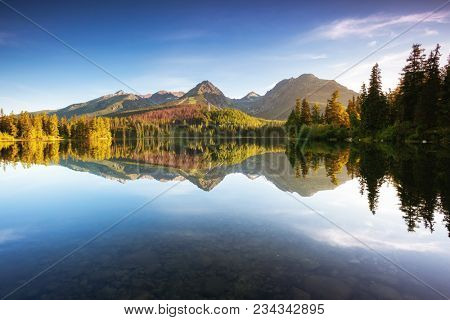 Beautiful mountain lake in National Park High Tatra. Location place Strbske pleso, Slovakia, Europe. Scenic image of amazing nature landscape. Breathtaking summer view. Discover the beauty of earth.