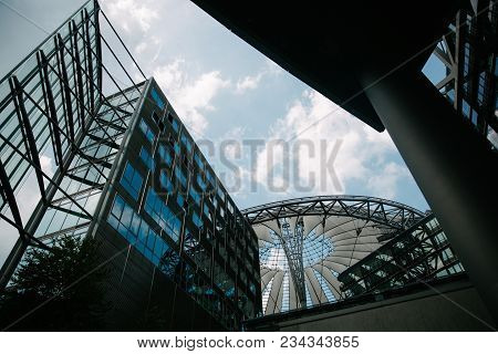Berlin, Germany - June 20, 2017: Low Angle View Of Modern Skyscrapers And Blue Sky, Potsdamer Platz,
