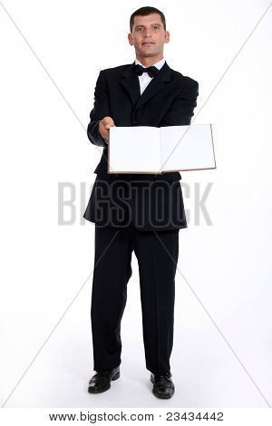 Waitor holding book