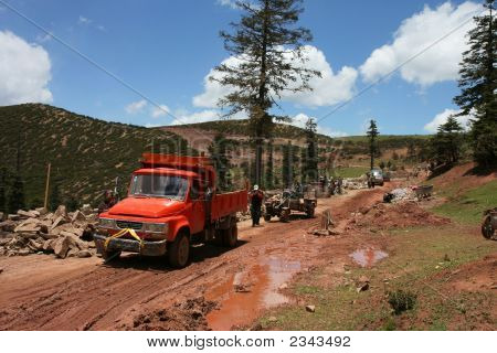 Trucks On Muddy Road