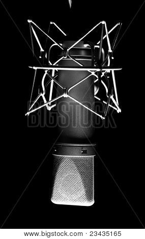 closeup of vintage microphone on a black background