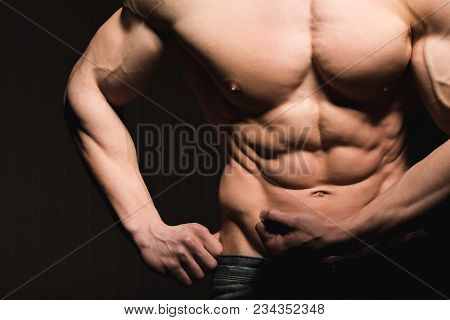 Muscular And Fit Torso Of Young Man Having Perfect Abs, Bicep And Chest. Male Hunk With Athletic Bod