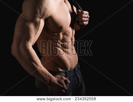Fitness Concept. Muscular And Fit Torso Of Young Man Having Perfect Abs, Bicep And Chest. Male Hunk