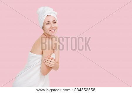 Beautiful young woman relaxing spa salon with selfi on mobile phone at spa resort