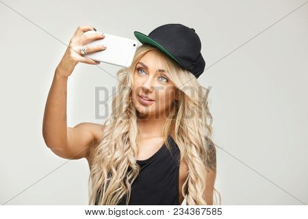 Girl Makes Selfie On Smartphone. Gorizontal Portrait, View Of The Phone. Self-portrait On Isolated W