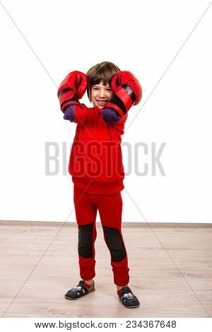 Smiling Boy With Red Boxing Gloves Over White Background