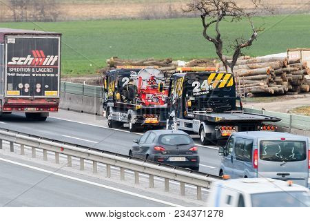 Slovenska Bistrica - March 23, 2018: Tow Truck Workers Cleaning Wreckage After Traffic Accident On H