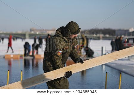 ST. PETERSBURG, RUSSIA - MARCH 4, 2018: Soldier dismount the podium after the winter swimming competitions for Big Neva Cup. Winter swimmers from 12 countries take part in the competitions this year