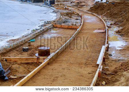 Sidewalk Under Construction, Concrete Curb Installation In Progress. Installation Of Formwork For Si