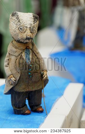 SAINT-PETERSBURG, RUSSIA - MARCH 22, 2018: Doll of Badger exposed on the exhibition Wind In The Willow during TeddyFun 2018. The exhibition of designed Teddy Bears is held annually since 2011