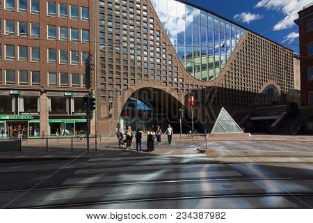 HELSINKI, FINLAND - JULY 15, 2017: People at the building of Helsinki University Library. It is the largest multidisciplinary university library in Finland