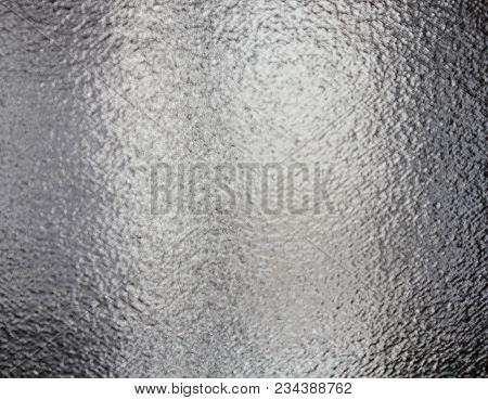 The Surface Of The Glass Is Opaque. Light Background From A Light Bulb With Glitter On The Glass. Te