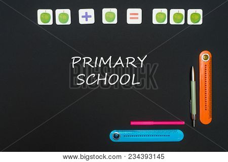 Concept School, Black Art Table With Stationery Supplieswith Text Primary School On Blackboard