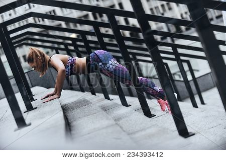 Sport Is The Way Of Her Life. Modern Young Woman In Sport Clothing Keeping Plank Position While Exer