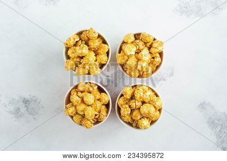 Caramel Popcorn In Paper Cups Multicolor On Gray Background. A Place For A Label