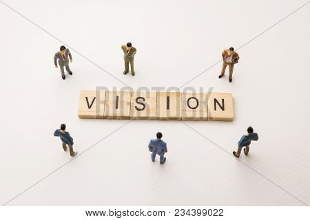 Miniature Figures Businessman : Meeting On Vision Word By Wooden Block Word On White Paper Backgroun