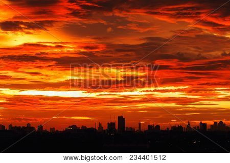 Sky Image With  A Dramatic Red Clouds After Sunset And Silhouettes Of Buildings