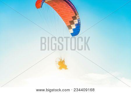 Flight On A Motor Glider In The Blue Sky With Bright Backlight Sunlight. Solar Illumination Of The P