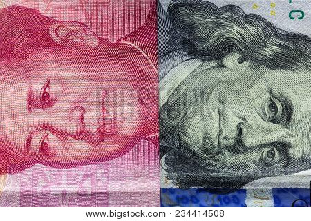 Close Up Of One Hundred Dollar And 100 Yaun Banknotes With Focus On Portraits Of Benjamin Franklin A