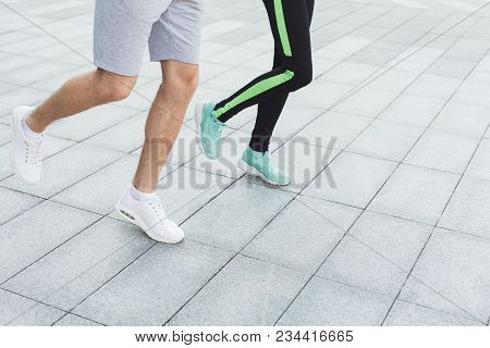 Male And Female Feet In Sneakers. Couple Running, Crop, Copy Space. Fitness, Sport, Foot Wear And He