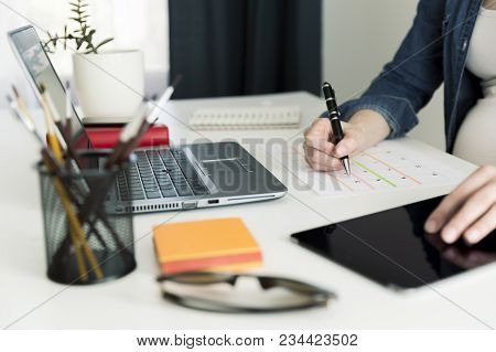 Calendar Planner Agenda Schedule Concept. Woman Working In Her Office, Working, Planning. Maternity