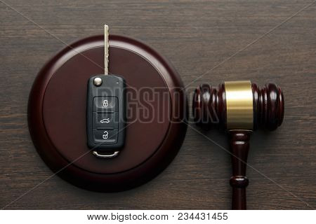 Close Up Of Wooden Judge Gavel And Car Keys Over Soundboard On White