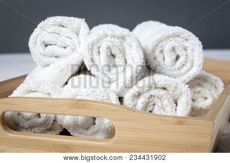 The White Spa Towels Pile In Tray Isolated On White Background