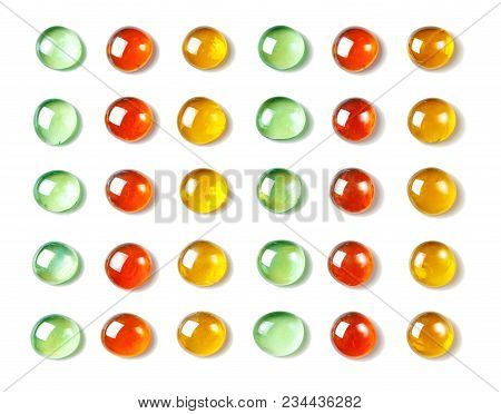 Pattern Of Red, Green And Yellow, Shiny Glass Beads. Isolated On White. Spa Background, Texture. Fla