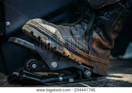 Worker Foot In Large Shoe Or Boot Presses On Pedal Of Industrial Excavator Or Tractor, Toned