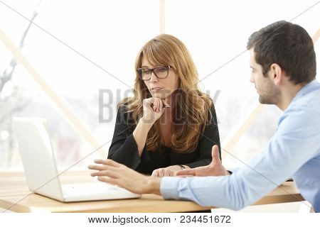 Group Of Business People Consulting At The Office