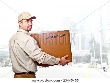 confident man holding a box