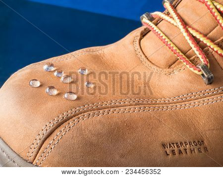 Rain Drops On Waterproof Clothes Shoes Boots With Waterproof Leather Sign On A Toe