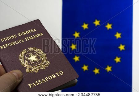 The Italian passport with the European Union flag on the background