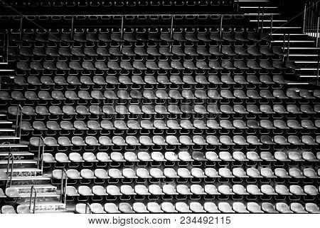Worn Rows Of Seats And Seats In A Disused Stadium.