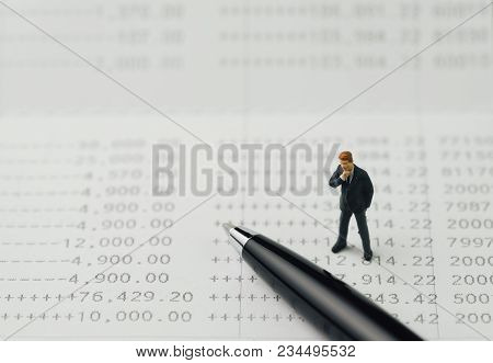 Growth Of Investment, Interest Compound In Saving Account, Miniature Businessman Standing And Thinki