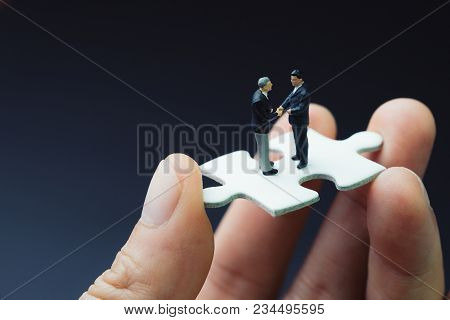Business Success Strategy With Collaboration, Teamwork Or Negotiation Jigsaw Key, Miniature People B