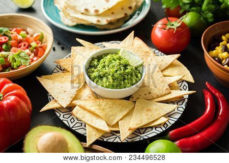 Guacamole, Tortilla Chips And Salsa. Mexican Food Selection. Closeup View, Selective Focus