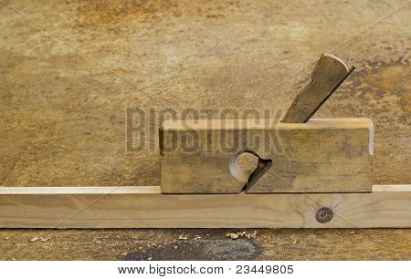 Planer On Wood In Rusty Background