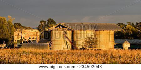 Warm Morning Light On These Old Farm Silos.