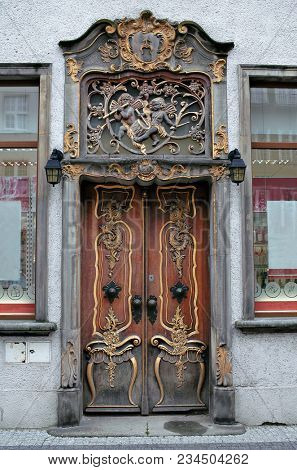 Ancient  decorated door in baroque style in Gdansk, Poland.