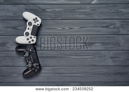 Computer Game Competition. Gaming Concept. Top View Of Two Joysticks On Wooden Table With Copy Space