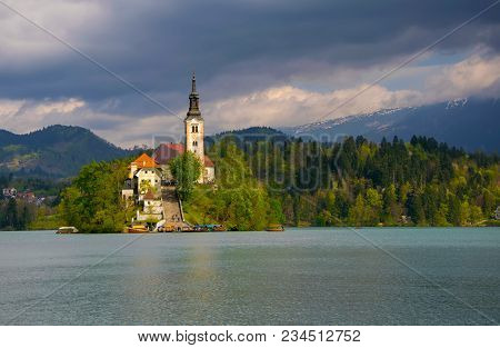 Magnificent Bled Lake. Blsde Island And Pilgrimage Church Of The Assumption Of Mary In Sunlit With M