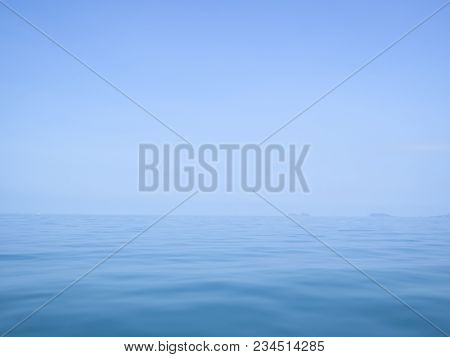 Calm Flat Surface Of Ocean Meeting Cloudless Clear Blue Sky At Horison, In The Gulf Of Thailand Betw