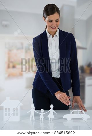 Woman with cut outs of insurance at home