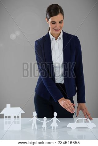 Woman with cut outs of house family and car insurance