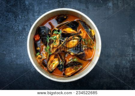 Traditional French Corsican mussel stew with mussels as top view in a pot with copy space