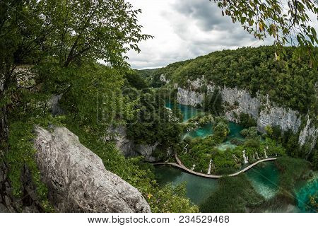 A Beautiful Top Landscape Of Azure Lakes Arranged In Cascades And Flowing Between Karst Mountains. T
