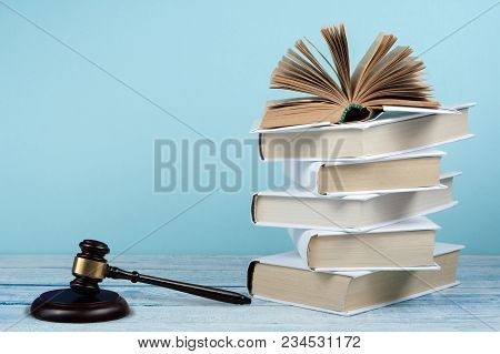 Law Concept Open Book With Wooden Judges Gavel On Table In A Courtroom Or Law Enforcement Office, Bl