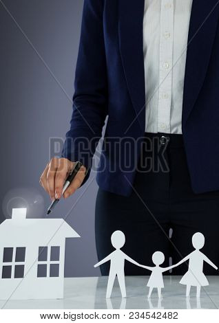 Cut outs of house and family with model