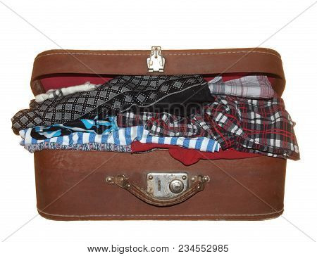 Old Suitcase Of Brown Color With One Metal Lock Isolated On White Background. Inside The Linen.